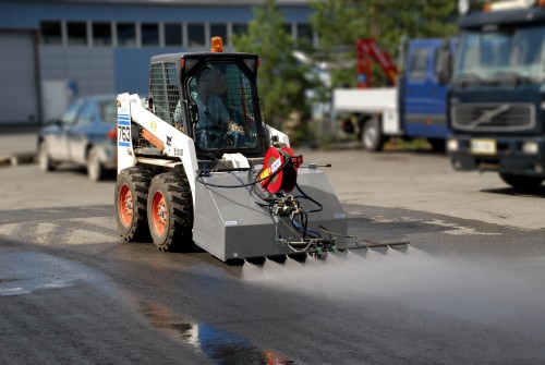 Dynaset Street Washing System cleaning a city street