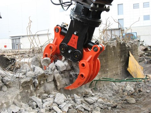 Demolition Grapple breaking concrete