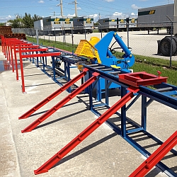 Blue conveyer line with alligator style rebar shear in the middle
