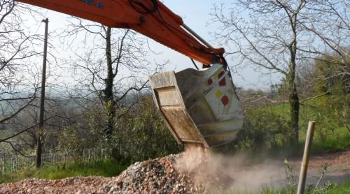 crusher bucket crushing rock at demolition site
