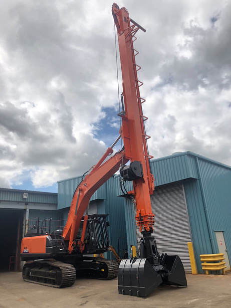 orange excavator with long telescopic teledipper arm attached to it