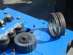 Blue Rebar Bending Machine with Spiral Hoop Sample on Top
