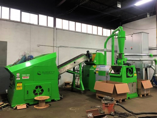 Green pre shredding machine and conveyer sending wire to granulator separator machine.